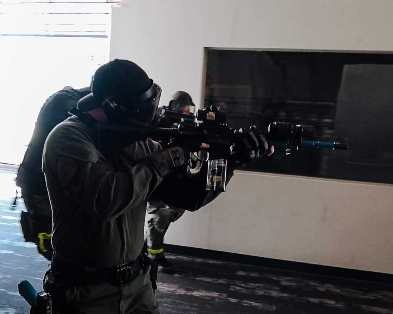Three man force on force team movement with carbine