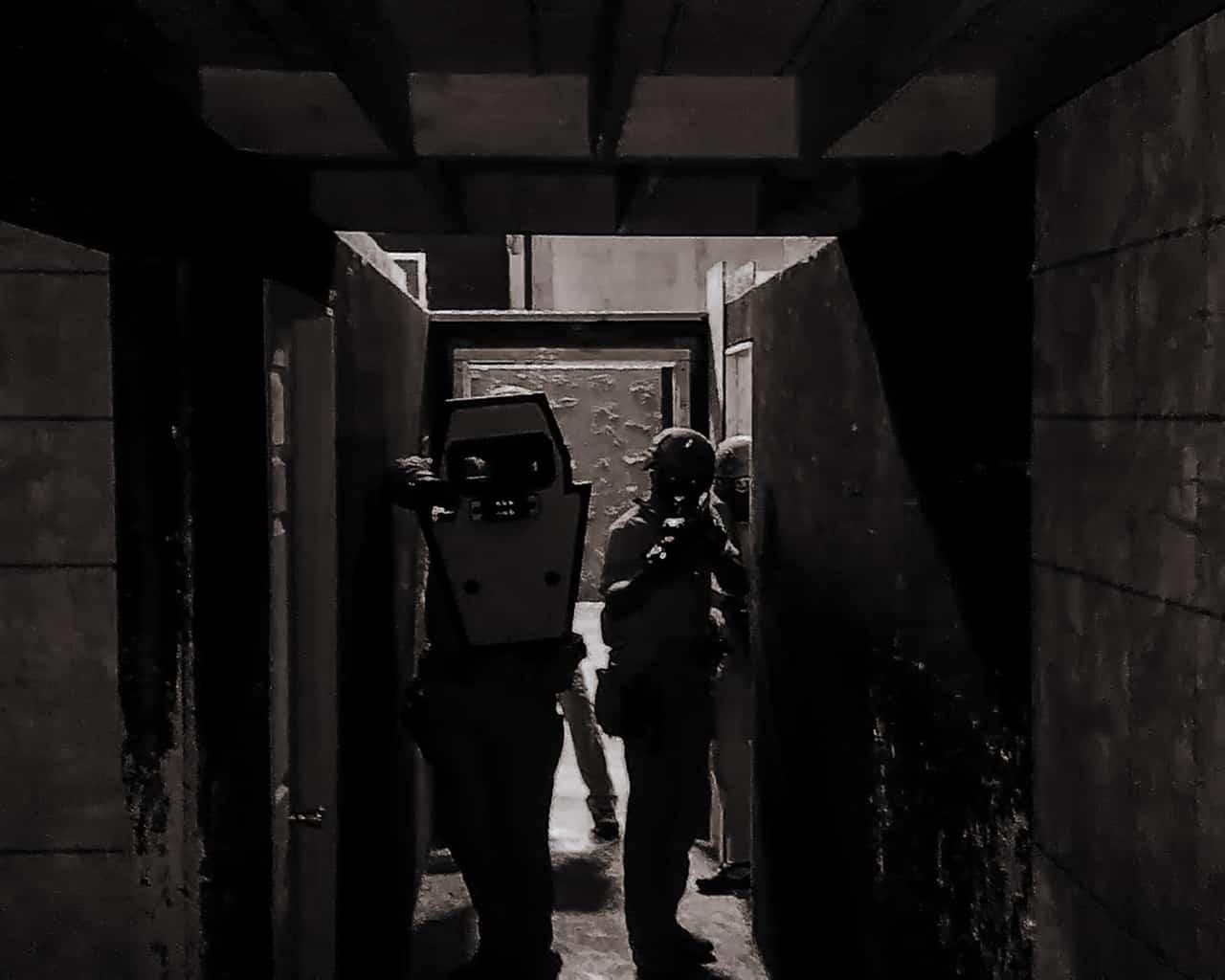 Entry team working hallways with shield