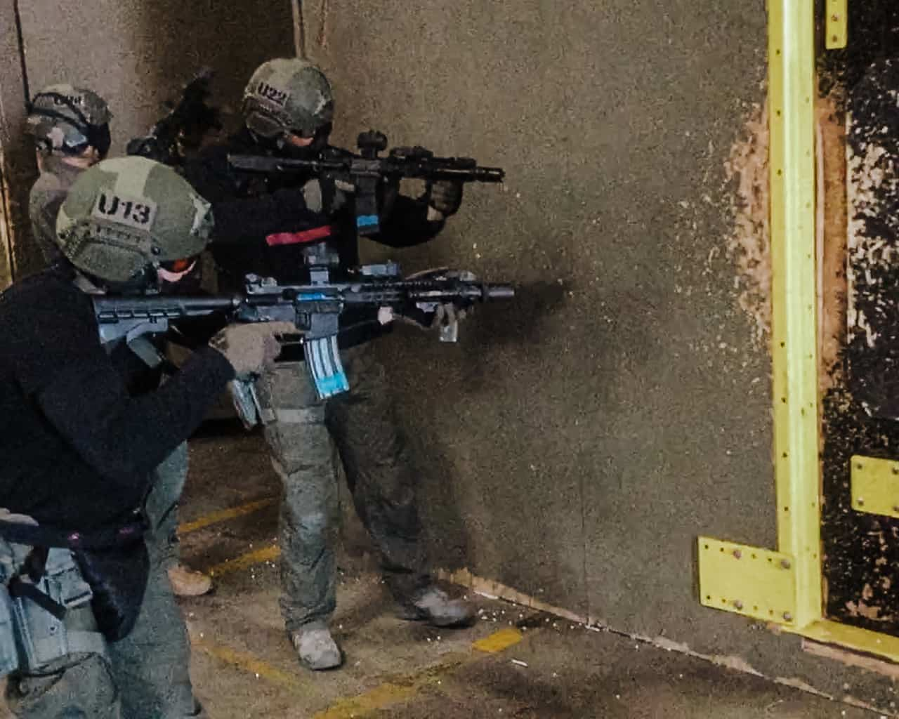 SWAT entry team taking the room from the outside