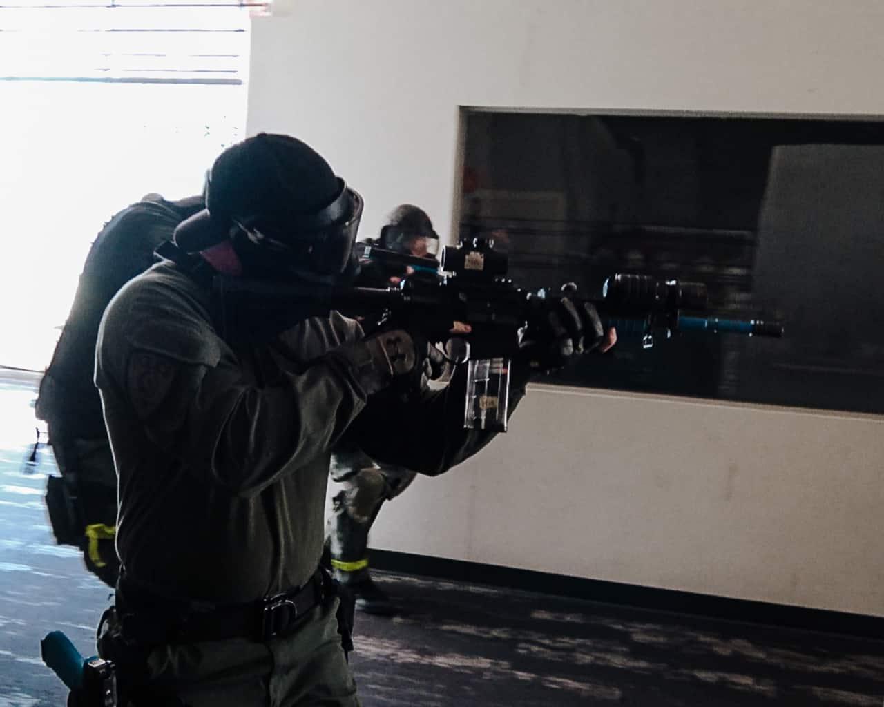 SWAT entry team working through building hallway