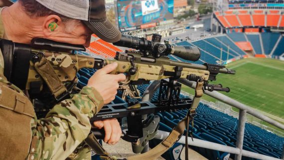 Police Sniper set up in the stadium stands for high angle shot during the Police Sniper response to a public venue course